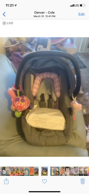 Car seat comes with stroller and bassinet all came together in box and is unisex, I put the pink headrest on it and it can be removed for Sale in Denver, CO