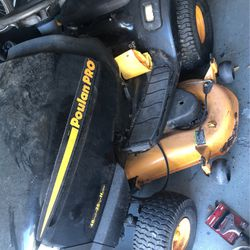 Used lawn tractor 48 inch cut 25 Horse Hydrostatic Dr. black and yellow for Sale in Port Orange,  FL