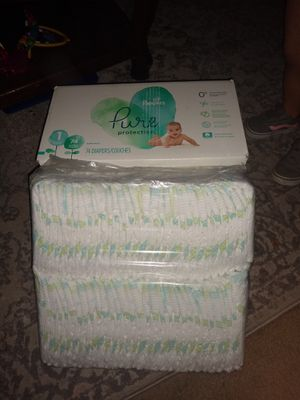 Un-opened diapers . One in bag are Costco brand, and un-opened Pampers. 10$ for Sale in Redlands, CA
