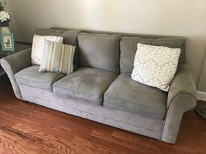 Khaki green microfiber couch from Raymour and Flanigan. Used but in good condition. for Sale in Penndel, PA