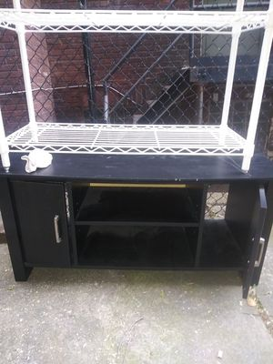 Excellent black TV stand with two doors for Sale in East Lansdowne, PA