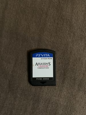 PS Vita Game -Assassin's Creed III Liberation and Also AC Charging Adapter for Sale in Modesto, CA