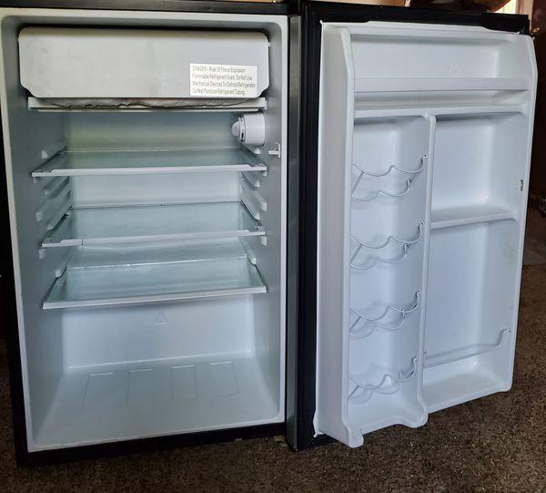 Dorm fridge, reclinging sofa and loveseat