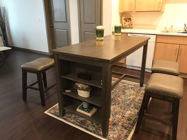 5 piece Counter Height dining room set. Table has 3 side shelves for storage