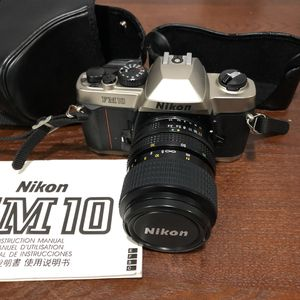 Nikon FM-10 35mm SLR Camera Kit with 35-70mm F3.5-4.8 Zoom Lens & Camera Case for Sale in Chicago, IL