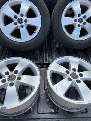 Four 16 inch Pontiac rims with two tires. for Sale in Spring, TX