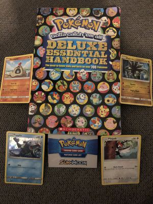 Pokémon deluxe essential handbook and 4 Pokémon trading cards for Sale in Compton, CA