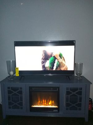 "43"" tcl Roku TV and fireplace stand for Sale in North Chesterfield, VA"