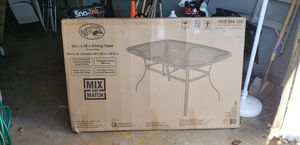 60x30 Glass outdoor patio table seats 6 never used for Sale in Revere, MA