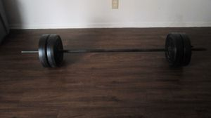 60 ld curl bar and weights for Sale in St. Louis, MO