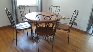 Wood dining kitchen round table with 4 rought iron chairs for Sale in Columbus, OH
