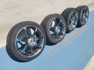 205/40/R17 Rims and tires good condition. One missing a cap. Universal. Fits any 4 lugs most cars.$400 for Sale in Cerritos, CA