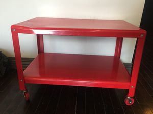Red table with wheels for Sale in Dallas, TX