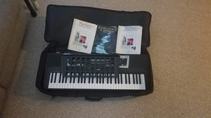 Electric keyboard with case and music books for Sale in Chicago, IL