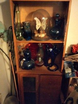 Five And A Half Foot Feet Tall . 22 Inch Wide Three Drawers. One Lower Cabinet With Glass Door. for Sale in Milwaukie,  OR