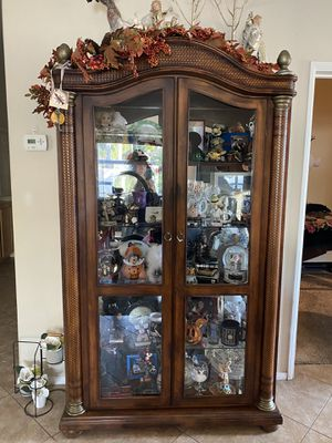 Beautiful Oak with glass shelves curio cabinet... excellent condition for Sale in Rancho Cucamonga, CA