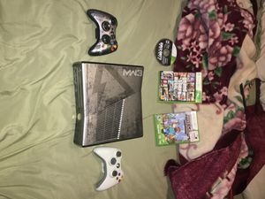 Xbox 360 excluding 2 controles and 3 games for Sale in Wichita, KS