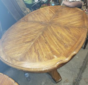Soild oak kitchen table with leaf hoand carved with 4oak chairs 200obo very heavy must sell for Sale in Oklahoma City, OK