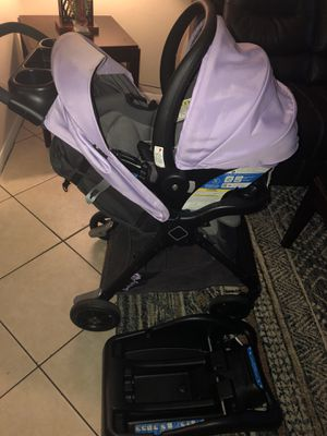 Lavender stroller with car seat and base for Sale in Stuart, FL