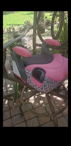 evenflo booster seat pink and grey in great condition baby seat ....LOCATED ON KROME AND SW 200ST for Sale in Homestead, FL