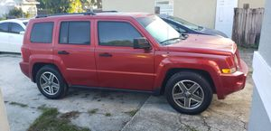 2008 jeep patriot w new rims and tires!! Runs great, ac! for Sale in Belle Isle, FL