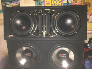 "SPX soundxtreme subwoofers California amp and off brand Bluetooth deck 2 10"" subs and 2 12"" subs 1 Bluetooth deck 1, 600 watt bridgable amp for Sale in Las Vegas, NV"