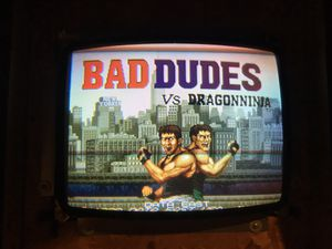 Bad dudes arcade game board and bezel tested works great for Sale in Glenview, IL