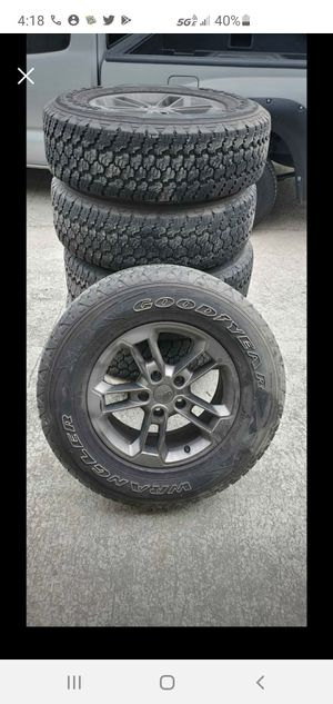 Jeep wrangler wheels and tires for Sale in Sugar Hill, GA
