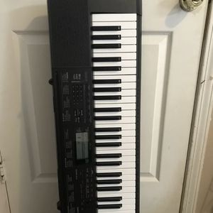 Casio Electric keyboard and stand for Sale in Muncie, IN