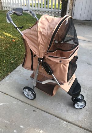 Brand new never used dog stroller regular size for Sale in Riverside, CA