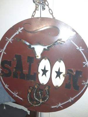 Maroon iron and metal hanging saloon sign for Sale in Amarillo, TX