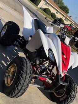 YAMAHA RAPTOR 350cc CON SUSPENCION DE MARCA CORRIENDO 👍 LISTA PARA USAR BILL SALE for Sale in Fontana,  CA