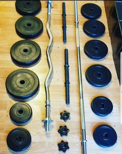 "5 foot standard 1"" barbell, 4 foot curl bar 2x dumbbell handles and 4x5lbs 4x2.5lbs 4x1.5lbs for Sale in Los Angeles,  CA"