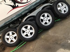"Jeep stock 17"" wheels 5 lug OEM rims with Goodyear Fortera 245/70R17 tires in good condition balanced ready to go $275 in Ontario 91762 for Sale in Newport Beach, CA"