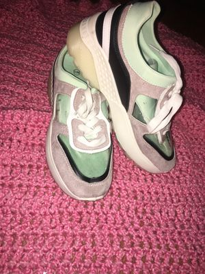 Tan, Teal, White, and Clear Tennis Shoe for Sale in El Dorado, AR