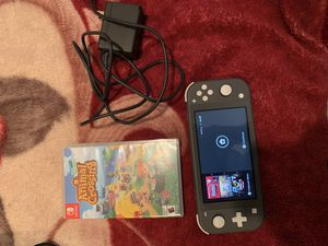 Nintendo switch lite + animal crossing (TAKING OFFERS) for Sale in Fontana, CA