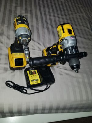 I am selling dewalt20 impact drill5Ah and hammer drill with 6 Ah battery with its charger ÷ in perfect condition no problem interested in buying text for Sale in Manassas, VA