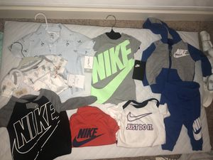 Lots of NIKE tags still attached to most items, free newborn diapers included for Sale in Puyallup, WA