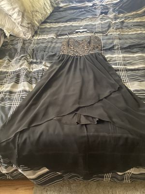 A black flowy Prom Dress, with skin tone lace-y with non-see-through pattern. for Sale in Jacksonville, FL