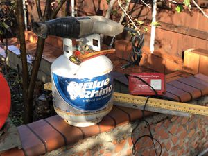 Saw saw, propane tank, battery charger, wrench & levels for Sale in San Diego, CA