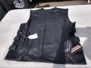 Xelement mens leather accent tactical vest. New with tags. Size XL. Genuine leather for Sale in Denver, CO