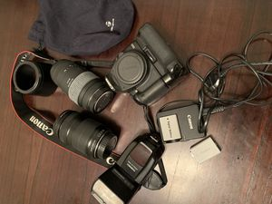 Canon EOS 500D with 2 Lens, camera extender, battery charger and everything. for Sale in Los Angeles, CA