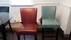 Dining room set, with 4 beautiful chairs to stand out. Colors of chairs are black, ivory, burgundy and turquoise for Sale in Hyattsville, MD