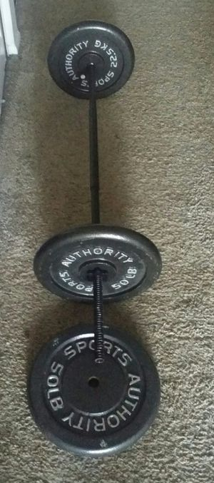 Weights iron 150lbs with 5 foot straight bar. 3x50lb weight plates and 2 weight locks. for Sale in Deerfield Beach, FL