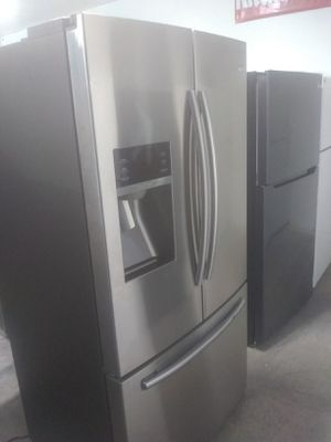 Samsung stainless steel french door refrigerator with water and ice dispenser on the front for Sale in San Luis Obispo, CA