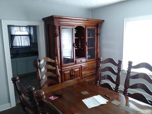 Antique singer furniture. Solid ladder back wood chairs(6) and table with 2 piece china cabinet. for Sale in Columbus, OH