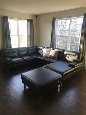 Black faux leather sectional w/ matching ottoman for Sale in Gambrills, MD