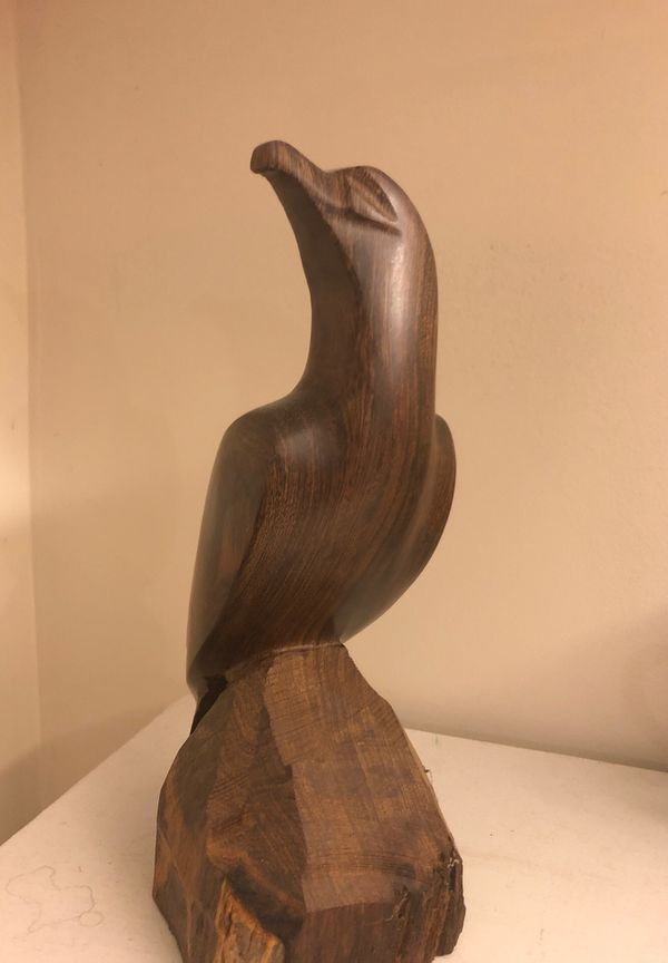 Hand carved solid wooden falcon