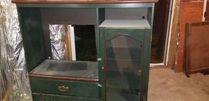 Entertainment center. Hunter green with brown top. Shelves enclosed with glass doors and 2 drawers at bottom. Price is negotiable. for Sale in Martinsburg, WV