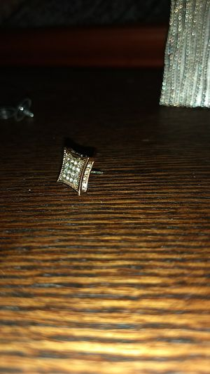 One single earring sterling silver diamond inlays paid a hundred bucks for the pair this one's missing two stones for Sale in Warren, MI